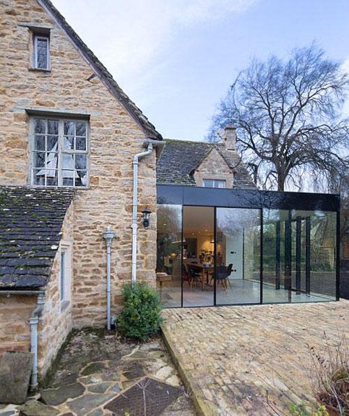 Extension moderne d'une maison ancienne